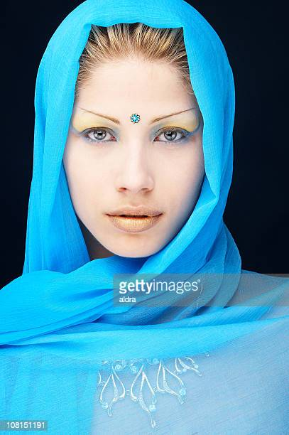 young woman wearing blue scarf around head with bindi dot - bindi stock pictures, royalty-free photos & images