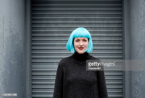 young woman wearing blue wig - blue hair stock pictures, royalty-free photos & images