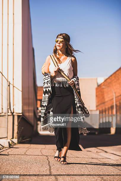Young woman wearing boho style walking on street