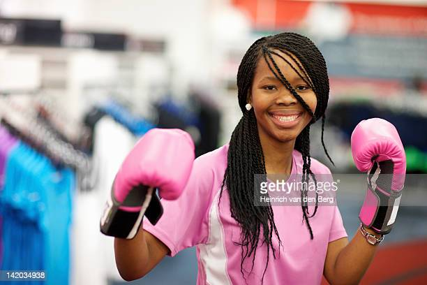A young woman wearing boxing gloves and looking at the camera, Pietermaritzburg, KwaZulu-Natal, South Africa