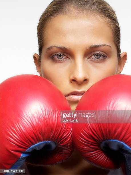 young woman wearing boxing gloves, portrait, close-up - women's boxing stock pictures, royalty-free photos & images
