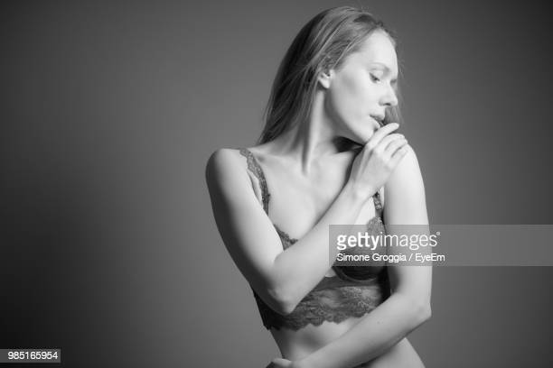 Young Woman Wearing Bra Against Wall