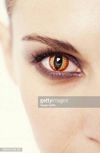 Young woman wearing cat's eye contact lens, close up
