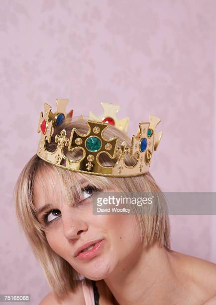 young woman wearing crown, looking up, close-up - crown close up stock pictures, royalty-free photos & images