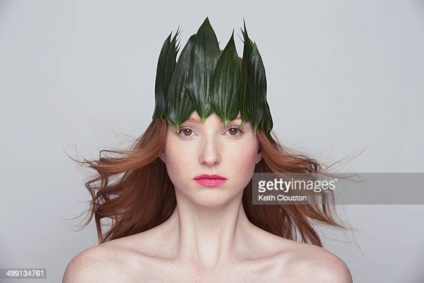 Young woman wearing crown of leaves
