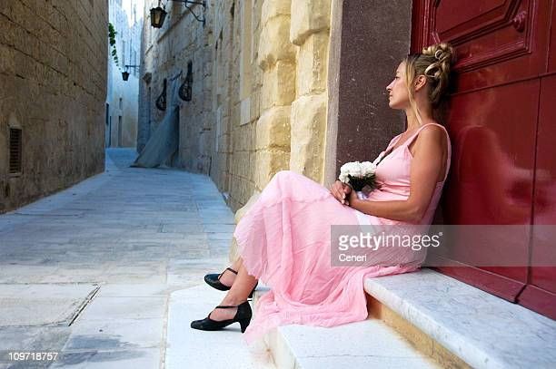 Young Woman Wearing Dress and Waiting Outside
