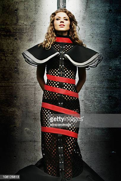young woman wearing dress and wrapped in red tape - bound woman stock photos and pictures