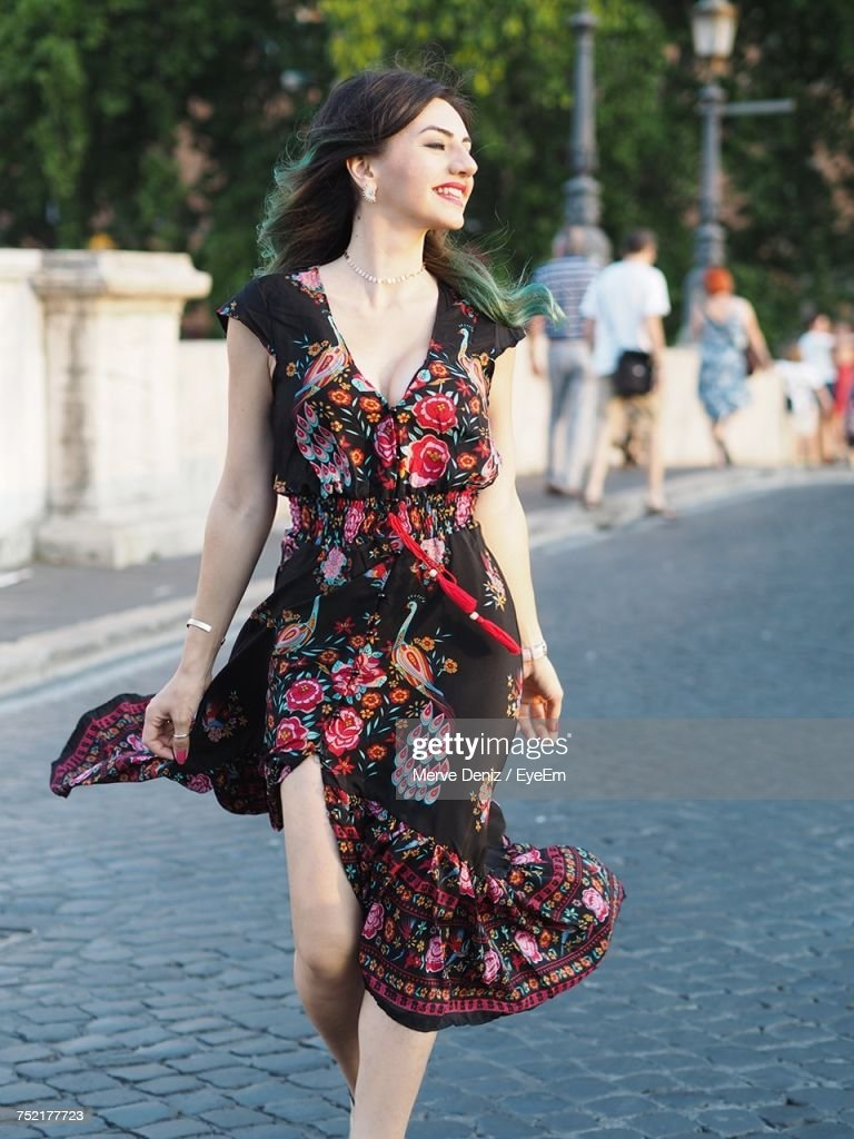 Young Woman Wearing Dress On Street : Stock Photo