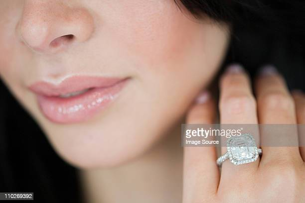 Young woman wearing engagement ring