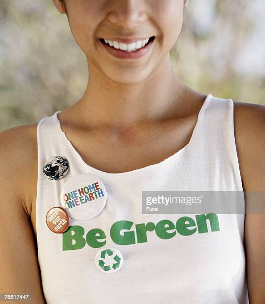 young woman wearing environmentalist tank top and buttons - campaign button stock pictures, royalty-free photos & images