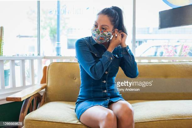 young woman wearing face mask - mini dress stock pictures, royalty-free photos & images