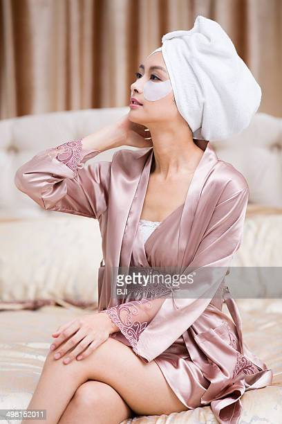 Young woman wearing facial mask