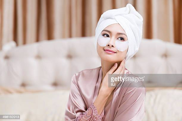 young woman wearing facial mask - cloth face mask stock pictures, royalty-free photos & images