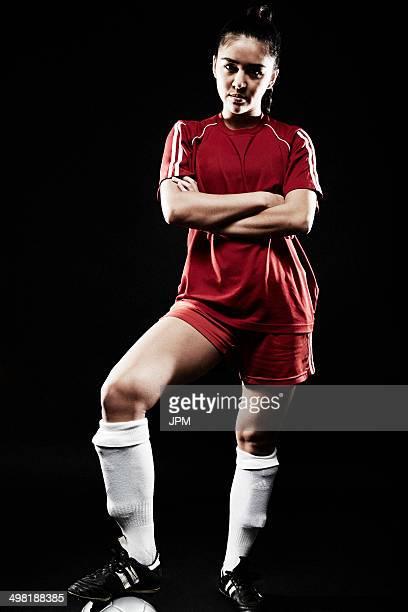 Young woman wearing football uniform