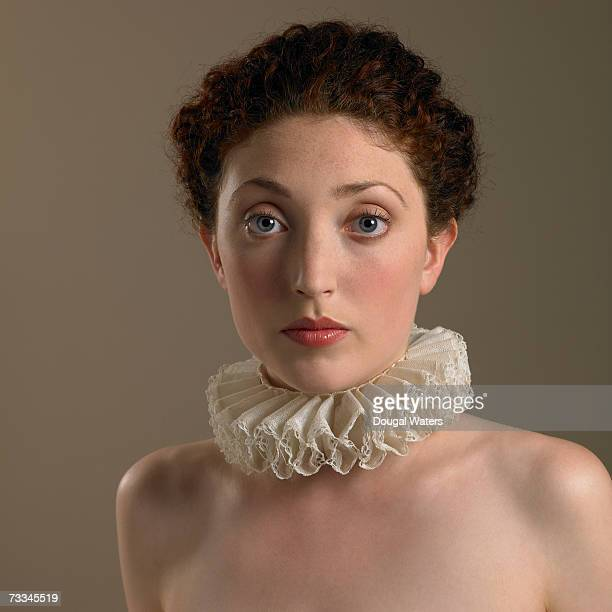 young woman wearing frilly collar, portrait - elizabethan collar stock photos and pictures