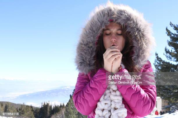 Young Woman Wearing Fur Coat Against Clear Sky During Winter