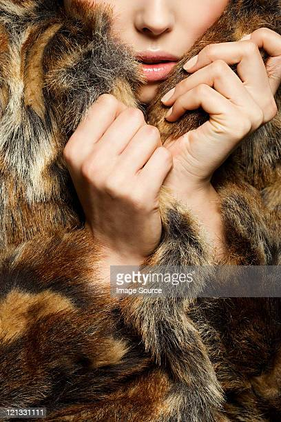Young woman wearing fur coat