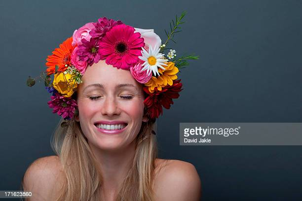 Young woman wearing garland of flowers on head
