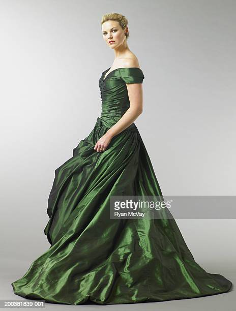 young woman wearing gown, portrait, side view - evening gown stock pictures, royalty-free photos & images