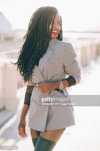 young woman wearing grey blazer in the city - black blazer stock pictures, royalty-free photos & images