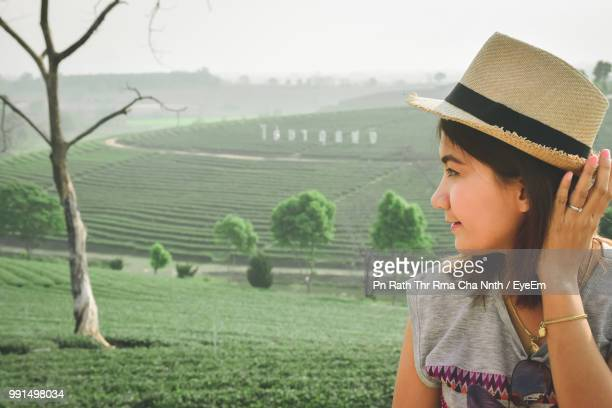Young Woman Wearing Hat Against Sky
