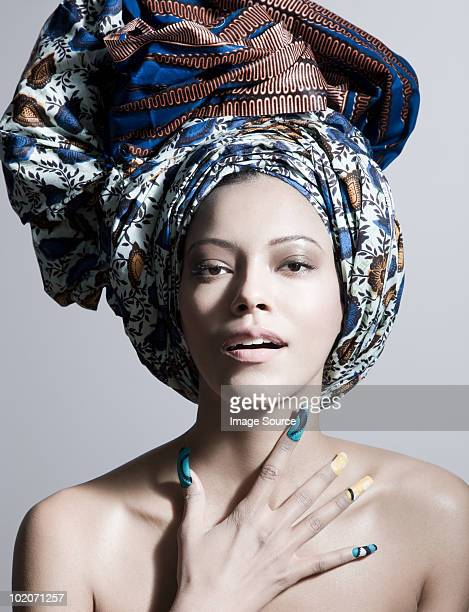 young woman wearing head tie and artificial nails - head tie fotografías e imágenes de stock