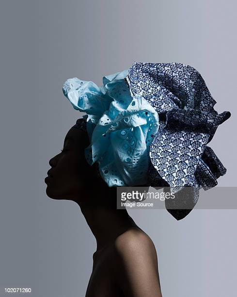 young woman wearing head tie - headdress stock pictures, royalty-free photos & images