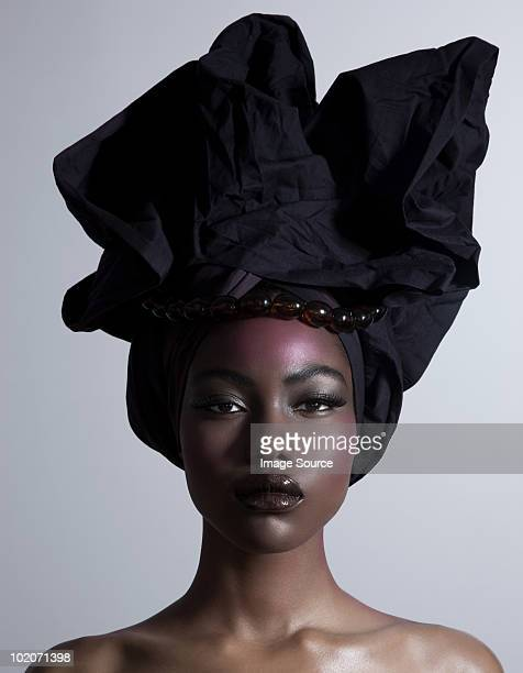young woman wearing head tie - head tie stock photos and pictures