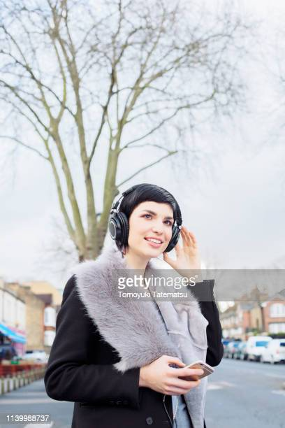 young woman wearing headphones - hairy woman stock pictures, royalty-free photos & images