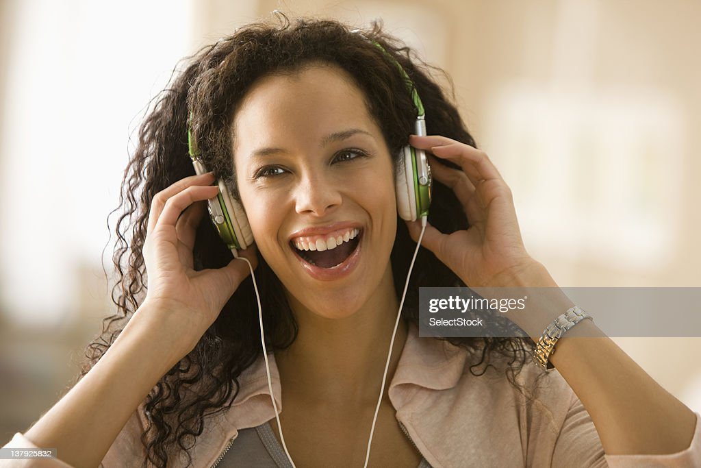 Young woman wearing headphones : Stock Photo