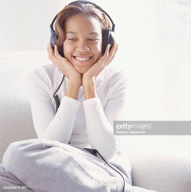 young woman wearing headphones - anthony-masterson stock pictures, royalty-free photos & images