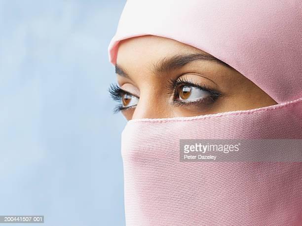 Young woman wearing hijab, close-up