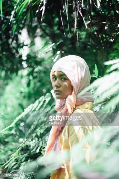 young woman wearing hijab - バングラデシュ ストックフォトと画像