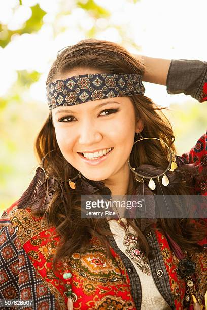 Young woman wearing hippy clothing