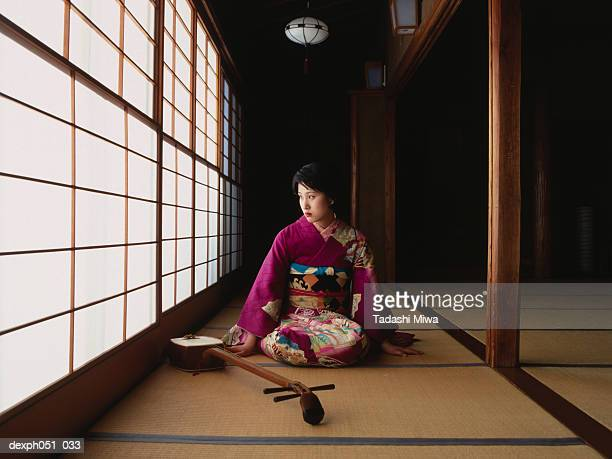 a young woman wearing kimono and 'samisen' - shamisen stock photos and pictures
