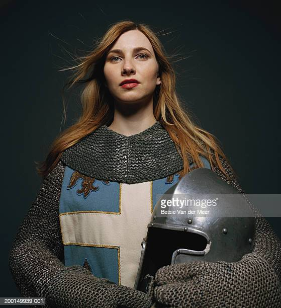 Young woman wearing knight outfit