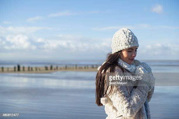 Young woman wearing knit hat, Brean Sands, Somerset, England