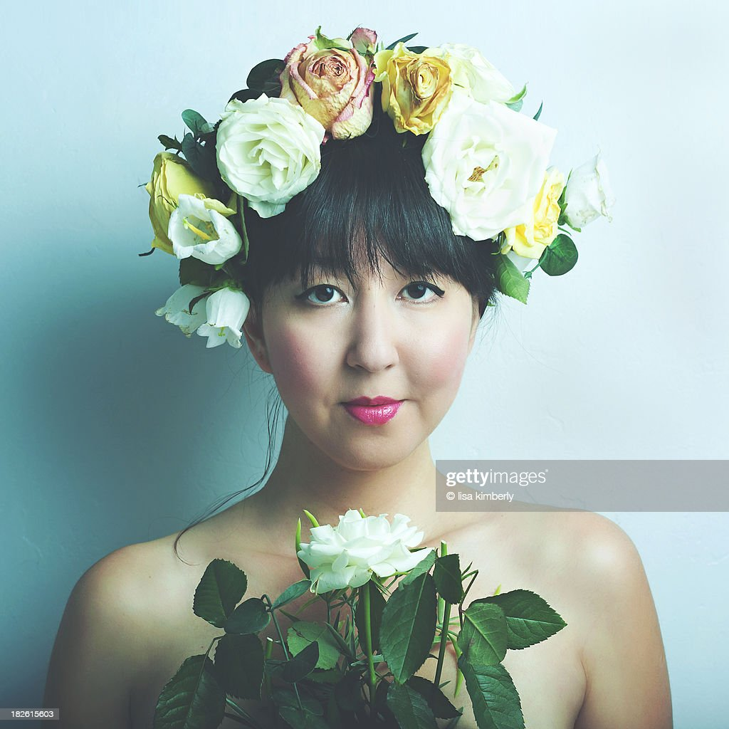 Young woman wearing large flower crown stock photo getty images young woman wearing large flower crown stock photo izmirmasajfo Gallery