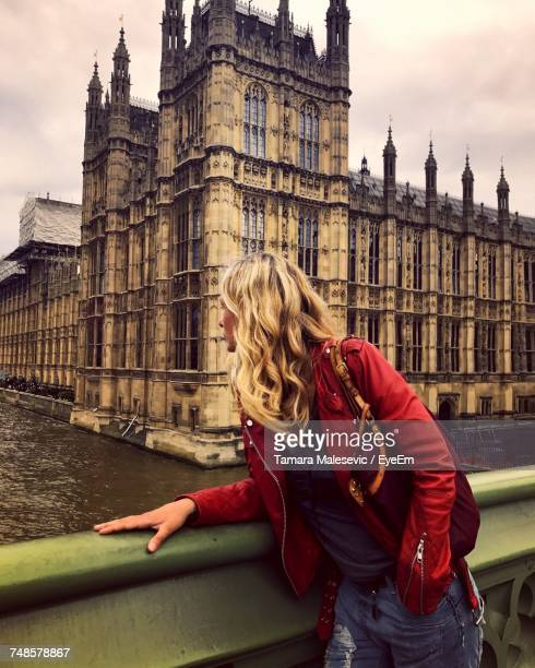 Young Woman Wearing Leather Jacket At Westminster Bridge In City