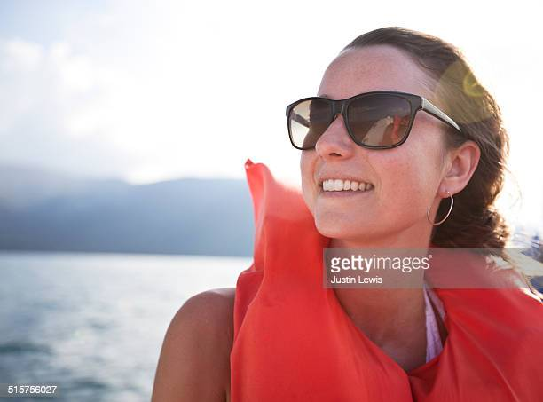 Young Woman Wearing Life Vest Boating on Bay