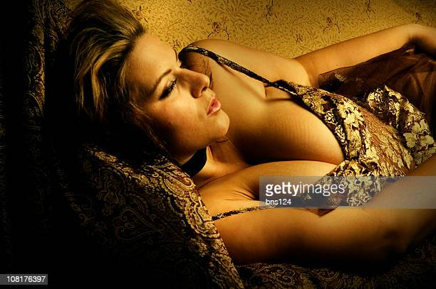 young woman wearing lingerie, low key - voluptuous breasts stock pictures, royalty-free photos & images