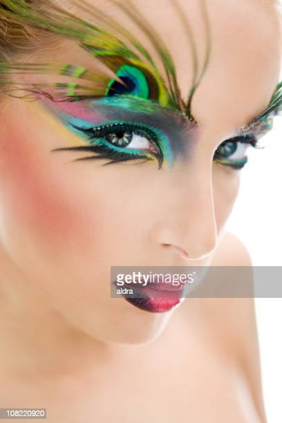 Young Woman Wearing Make-Up and Peacock Feathers on Eyebrows