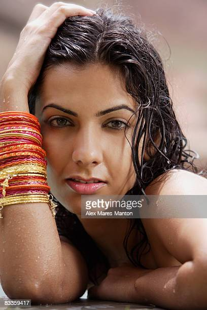 young woman wearing many bangles