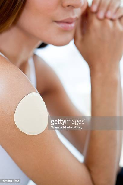 Young woman wearing nicotine patch