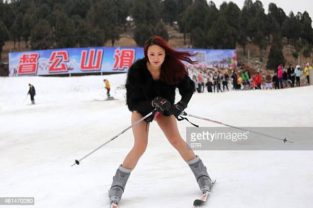 Young woman wearing no trousers hits the ski slopes at a ski resort in Xuzhou, in east China's Jiangsu province on January 13, 2015 in a promotional...