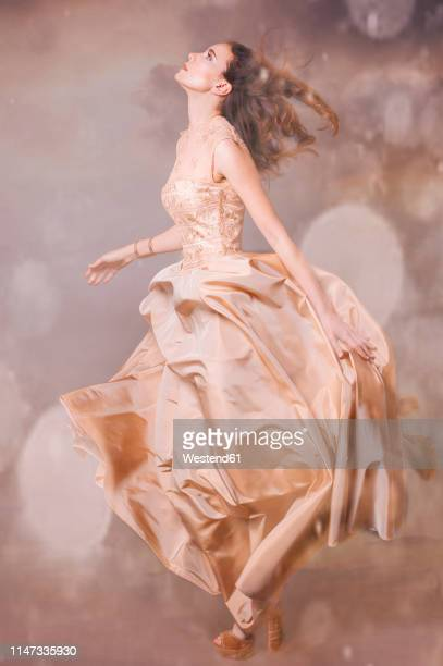 young woman wearing nude-colored evening dress - ヌードカラー ストックフォトと画像