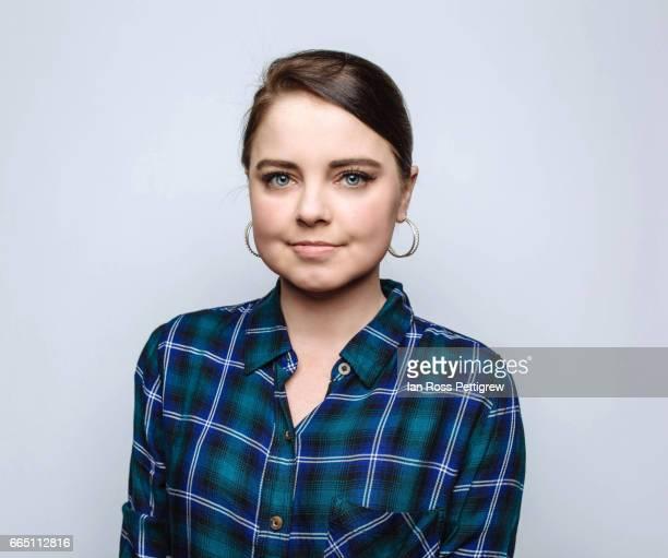 young woman wearing plaid shirt