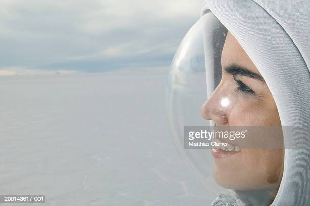 Young woman wearing protective bubble on face, side view, close-up