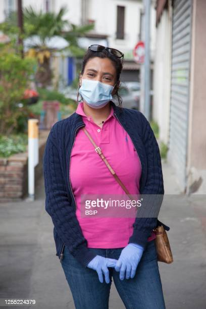 Young woman wearing protective mask and gloves against coronavirus with special permission to go shopping for basic necessities.