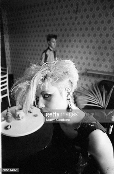 A young woman wearing punk fashions at a squat in south London 1983